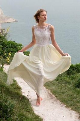 Sleeveless Illusion Lace Appliqués Chiffon A-line Beach Wedding Dress Featuring Open Back